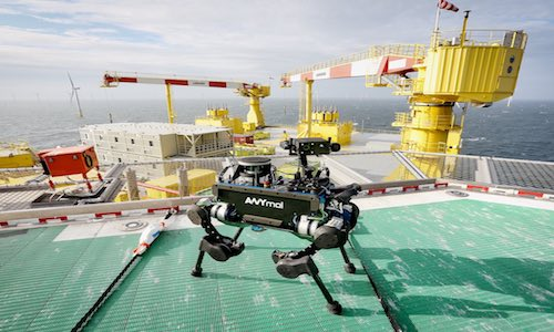 A photo of industrial quadruped ANYmal on an offshore drilling rig in the North Sea